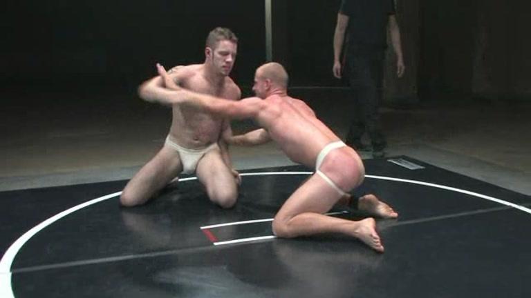 Stud Fighters Wrestling In Oil