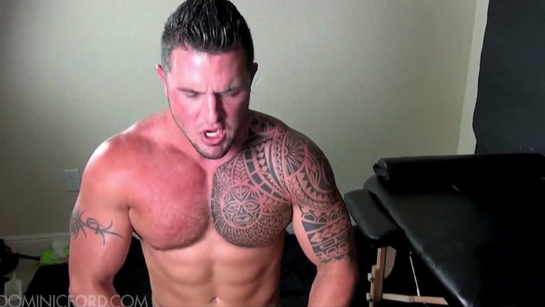 Muscle Tattooed Hunk Shoots