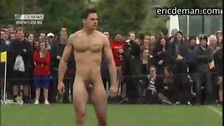 Athletes Playing Game of Naked Rugby