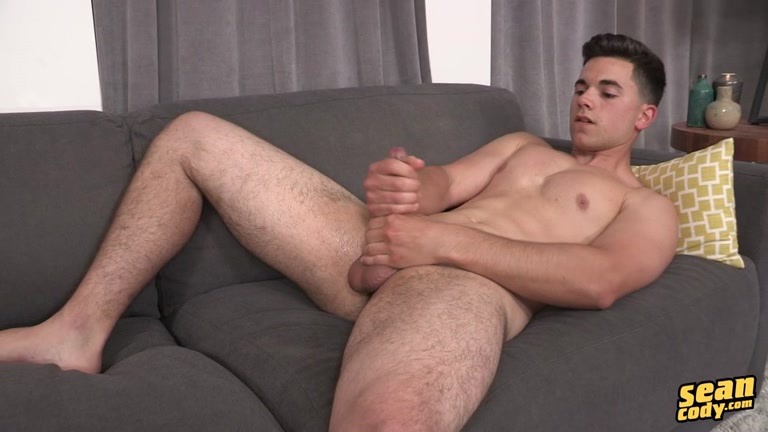 sexy guy pumps out a wad on the couch