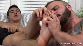 Interracial gay male feet worship photo