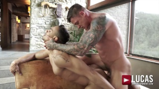 top hunk fucks upside bottom in a chair at Lucas Entertainment