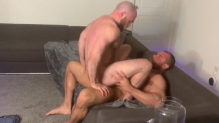 bearded bald man rides a beefy muscle hunk's cock