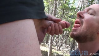 bearded guy gobbles down his lover's cum load outdoors