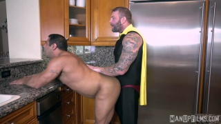 man in cape fucks a beefy muscle man in his kitchen