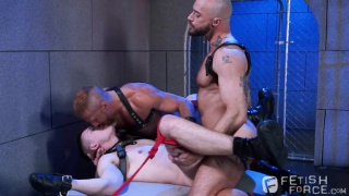 puppy boy tied to bed with a cock cage on his dick