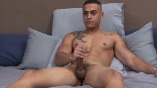ripped guy strokes his thick cock at ACtive Duty