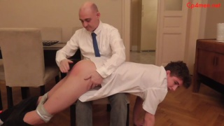 man in shirt & tie takes a waiter over his knee
