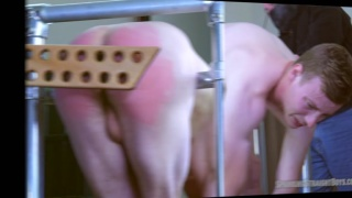 guy on the spanking rail gets his ass paddled