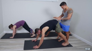 yoga instructor helps client with suggestive poses and then ...