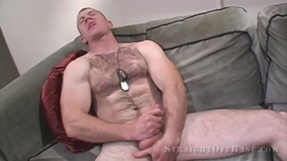 furry marine strokes his cock and holds his balls