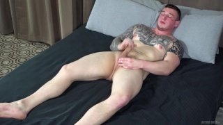 inked hunk stroking his thick cock