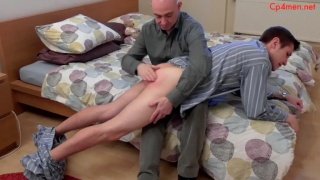 guy gets his pyjamas pulled down for a spanking