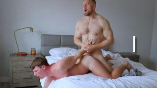 guy has his hands held behind his back while getting fucked