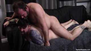 sexy daddy bear lies face down on the couch & gets drilled