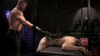 beefy master trains his new slave in the dungeon