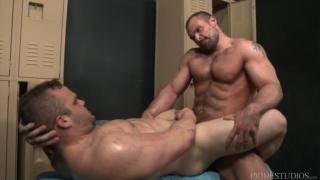 big muscle hunk fucks a guy's butt in locker room
