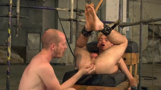 slave boy's cock ropped & tugged by a winch