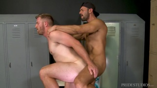 guy rubs his buddy's shoulder in the locker room and then ...