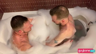 horny guys in a bubble bath suck dick & fuck