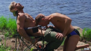 hunky fisherman gets head by the lake