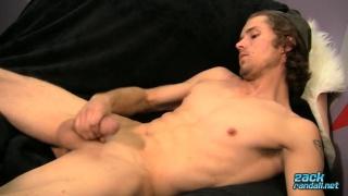 Str8 scruffy-faced guy jerks his long cock at Zack Randal