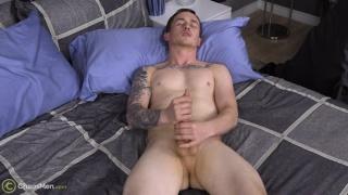 military-looking dude strokes his big cock