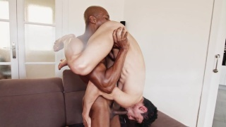 black man holds spanish guy in standing 69 suck session