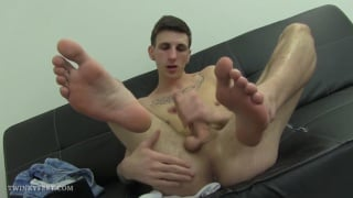 twink sucks his toes during a jack-off session