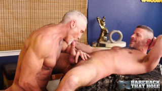 handsome silver daddy fucks a horny bottom at Bareback that Hole