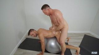 guy gets fucked with a large cock on a yoga ball