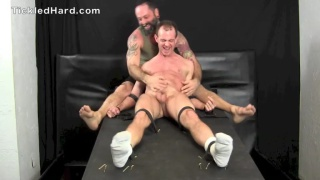 ripped stud strapped down and tickled
