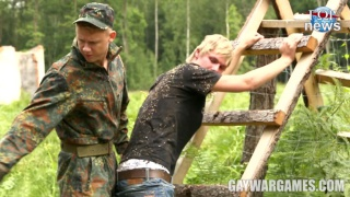 blond guy roughed up by soldier