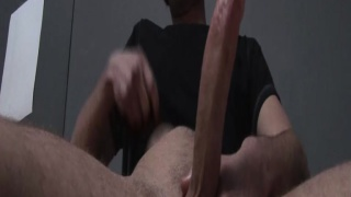 Masturbating his huge lubed cock