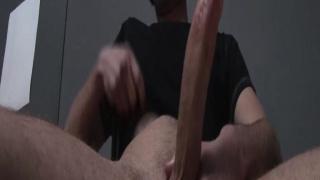 Masturbating his huge lubed cock