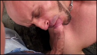 older muscle guy plays with a skinhead