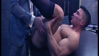 suited hunk fucked on board room table