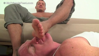 Alpha male gets his bare feet worshipped