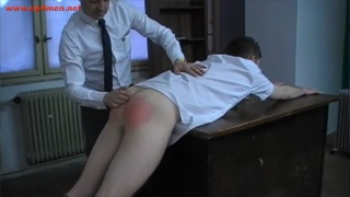 school's spanked ass is blazing red
