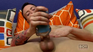 slim guy plays with masturbation sleeve