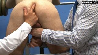 pervy doctors checking prisoner's bum