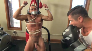 stud tied of gym equipment and punched
