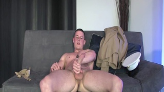 Marine strokes his hard cock