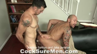 Tattooed men fucking on couch