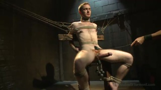 redheaded sub chained to the dungeon chair