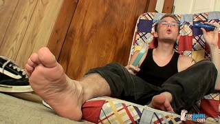 Billy plays with his feet and hard cock