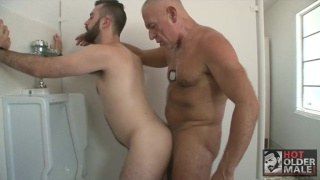silver daddy fucking man's ass in public toilet