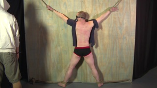 blond sub caned at roped stud