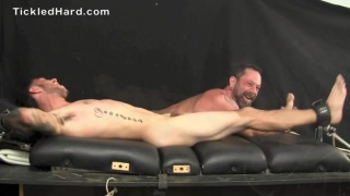 young businessman Evan at tickled hard